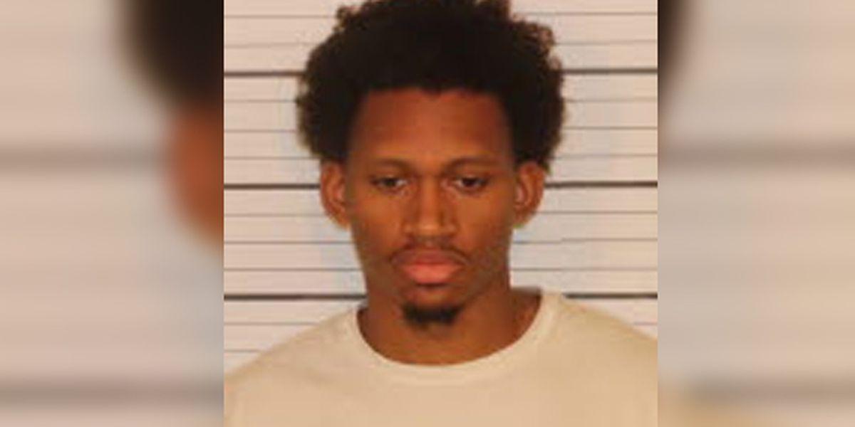 Man arrested after FedEx badge left at shooting scene