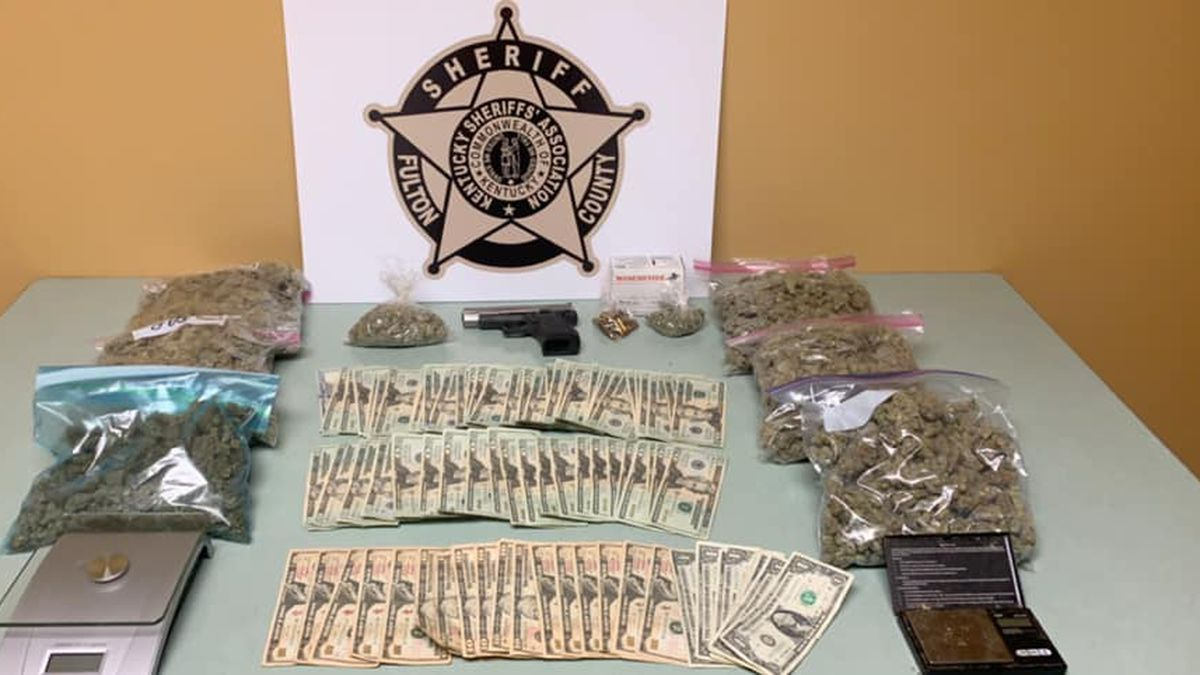 Police: Drugs, money, gun found in search