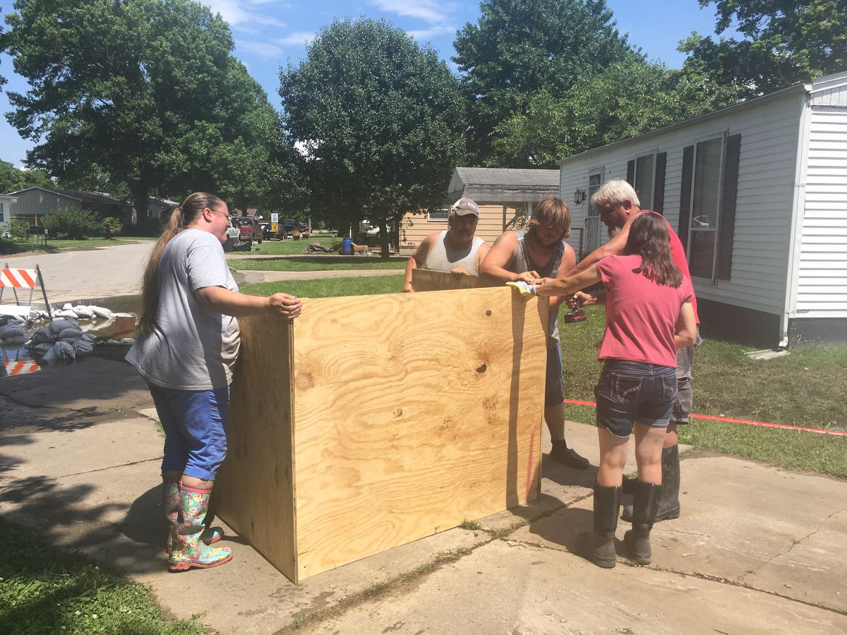Neighbors build structure to protect electric box from water