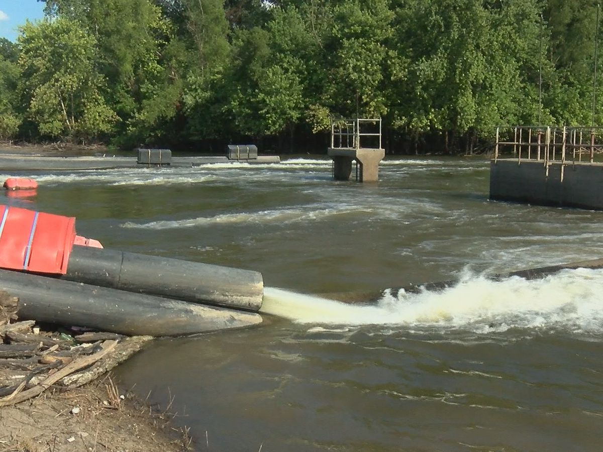 Gravity drains open to flush out floodwaters in Alexander County, Ill.