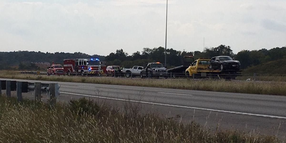 Driver facing charges after police car hit near crash on I-55