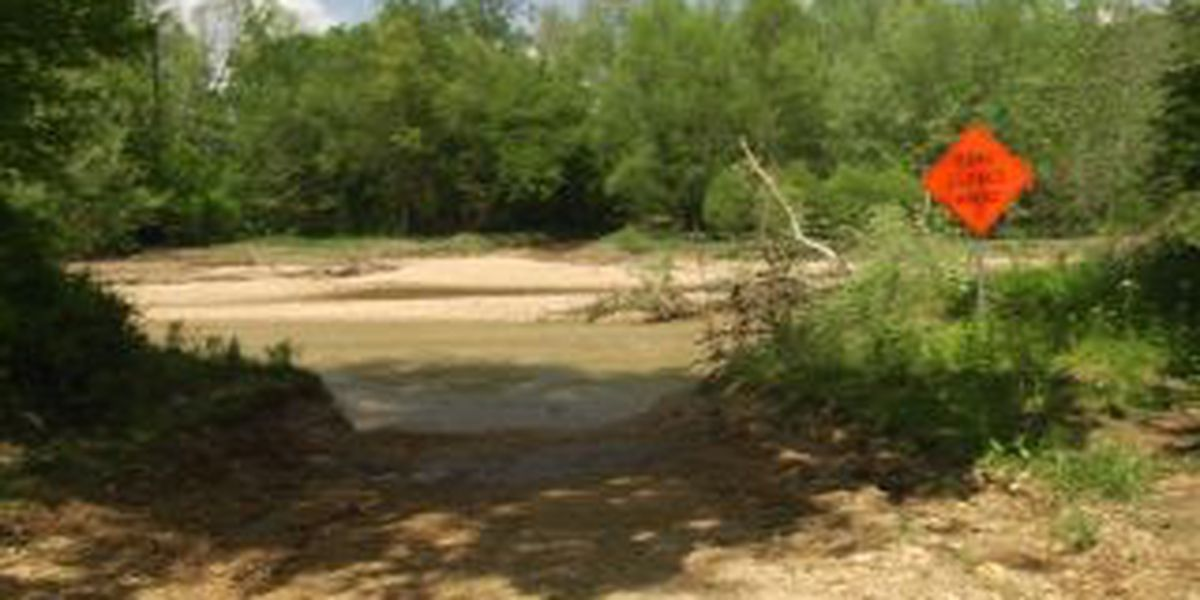 2 rescued after being swept away in creek