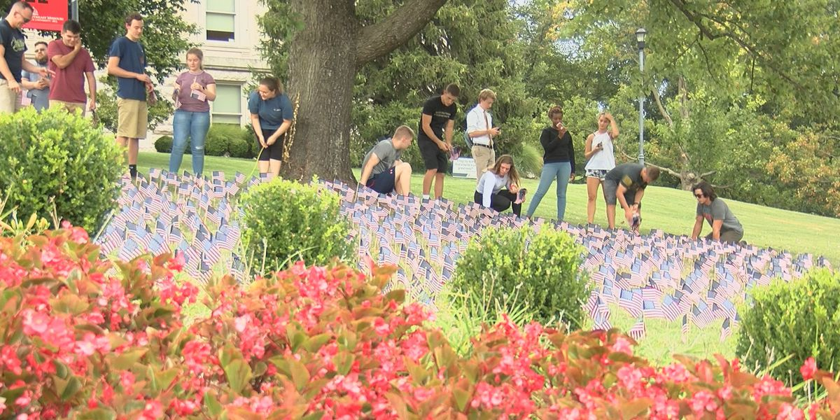 Volunteers place flags ahead of Patriot's Day ceremony at Southeast Missouri State University