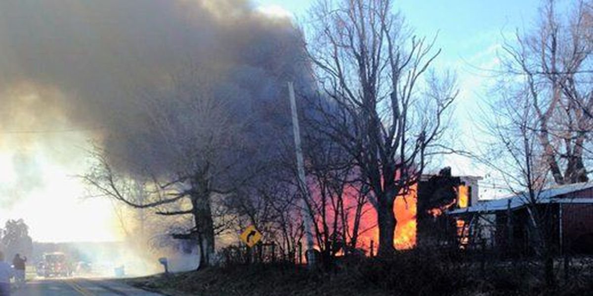 House fire closes road in Trigg County
