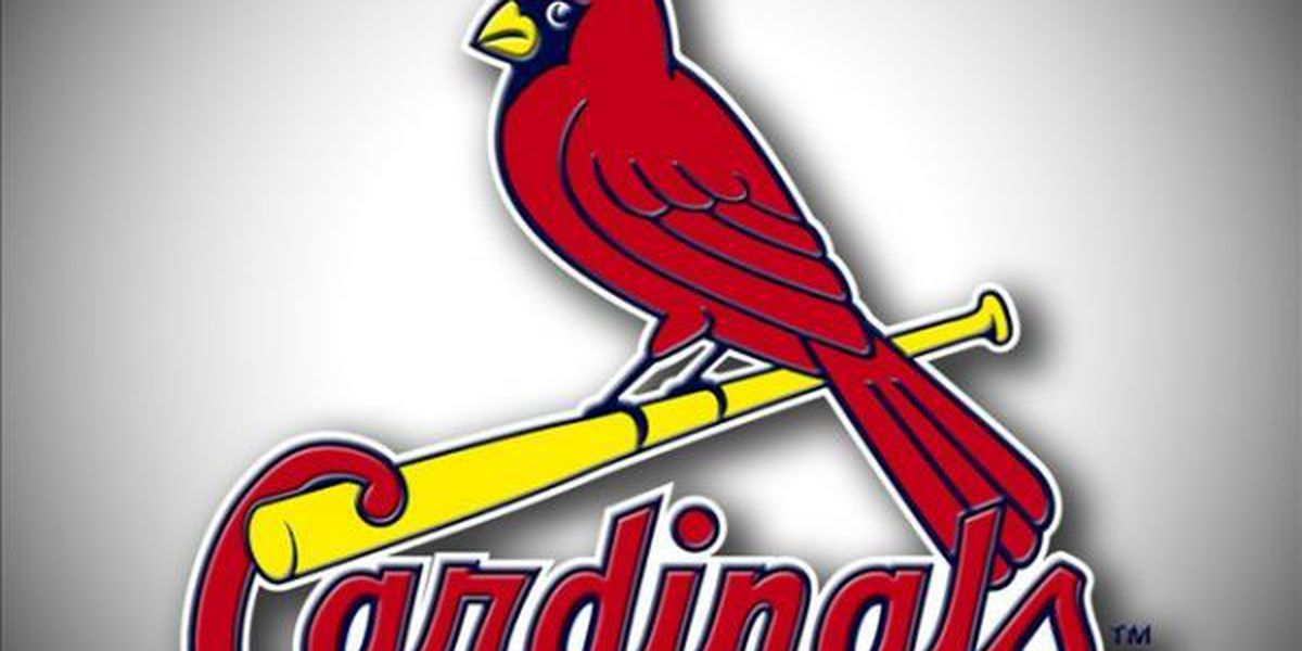 Cards survive Marlins late rally to win opener