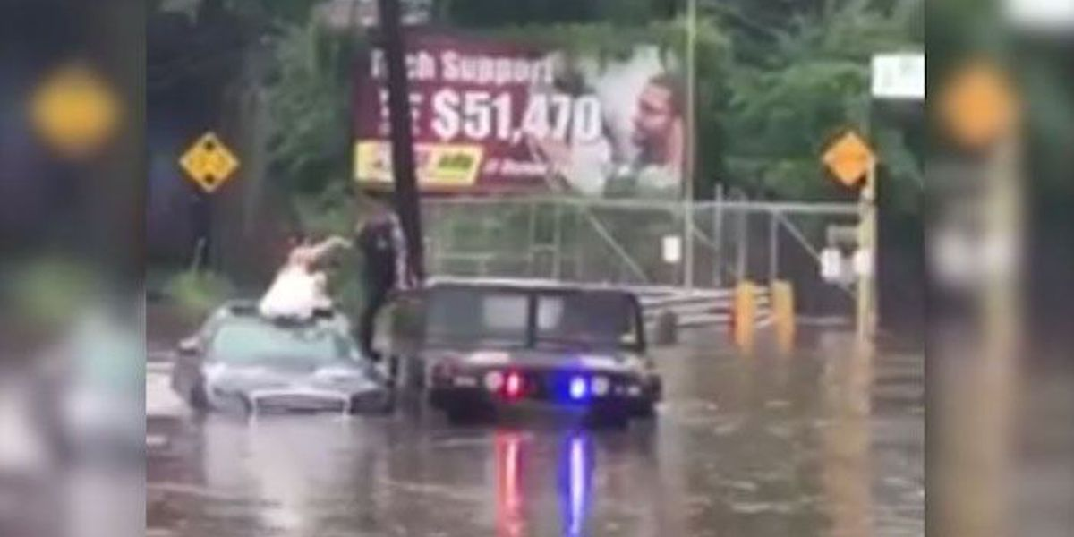 WATCH: Newlyweds rescued on wedding day after car trapped in floodwaters