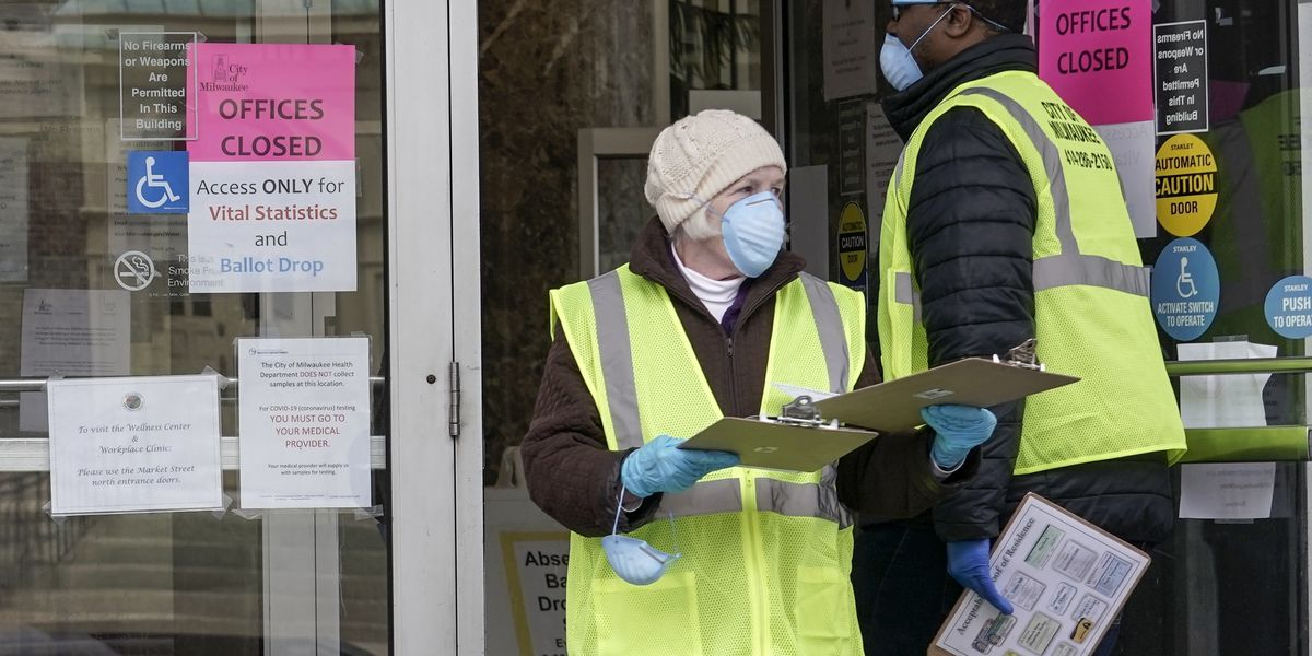 Wisconsin voters wait for hours, others stay home amid coronavirus