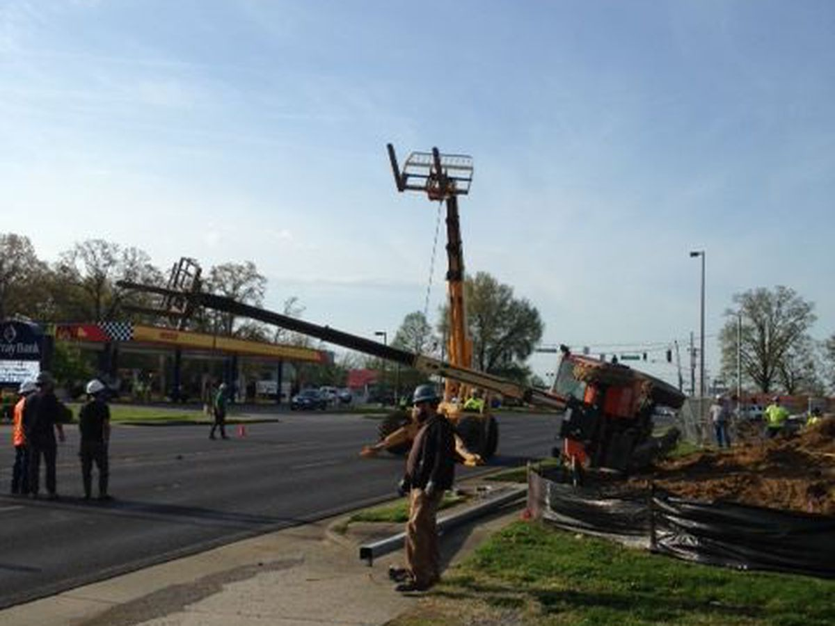 Crane flipped over, blocking traffic in Murray