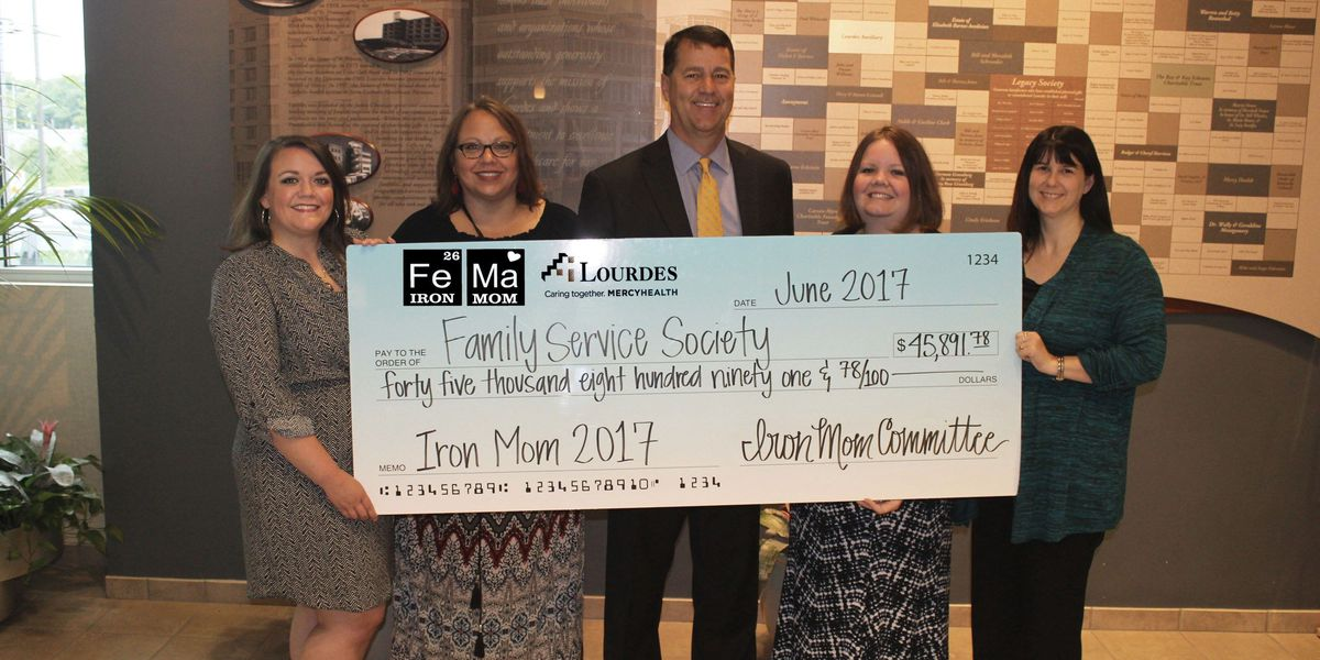 Family Service Society receives proceeds from the Lourdes Paducah Iron Mom Half-Marathon