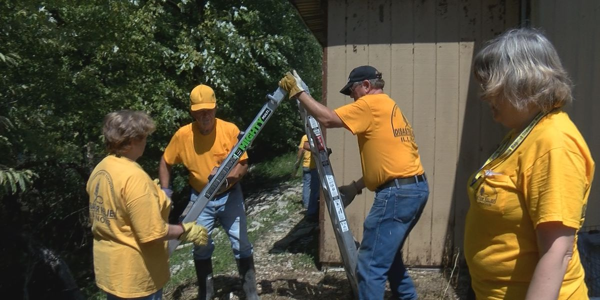 Crews work with homeowners to removed damage to homes caused by floodwaters in Alexander County, Ill.