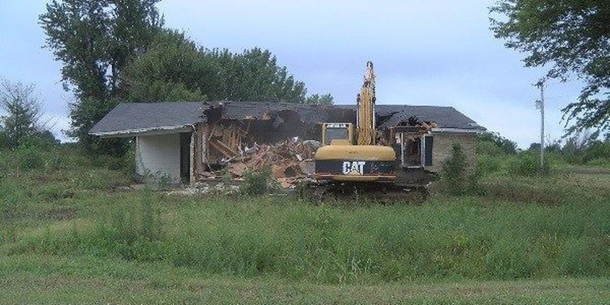 Residents come out to watch demolition start in Pinhook, MO.
