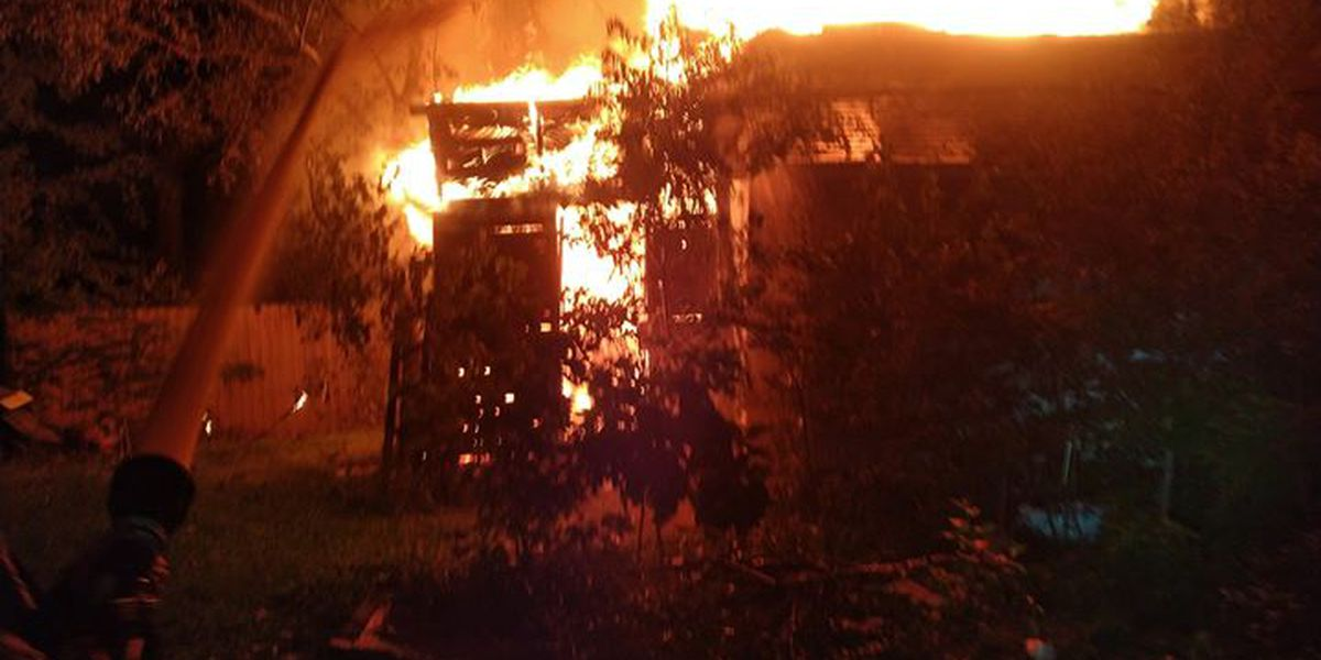 Crews battle late night house fire