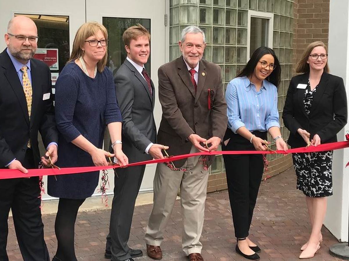 Southeast Missouri State University celebrating opening of International Village with ribbon-cutting ceremony