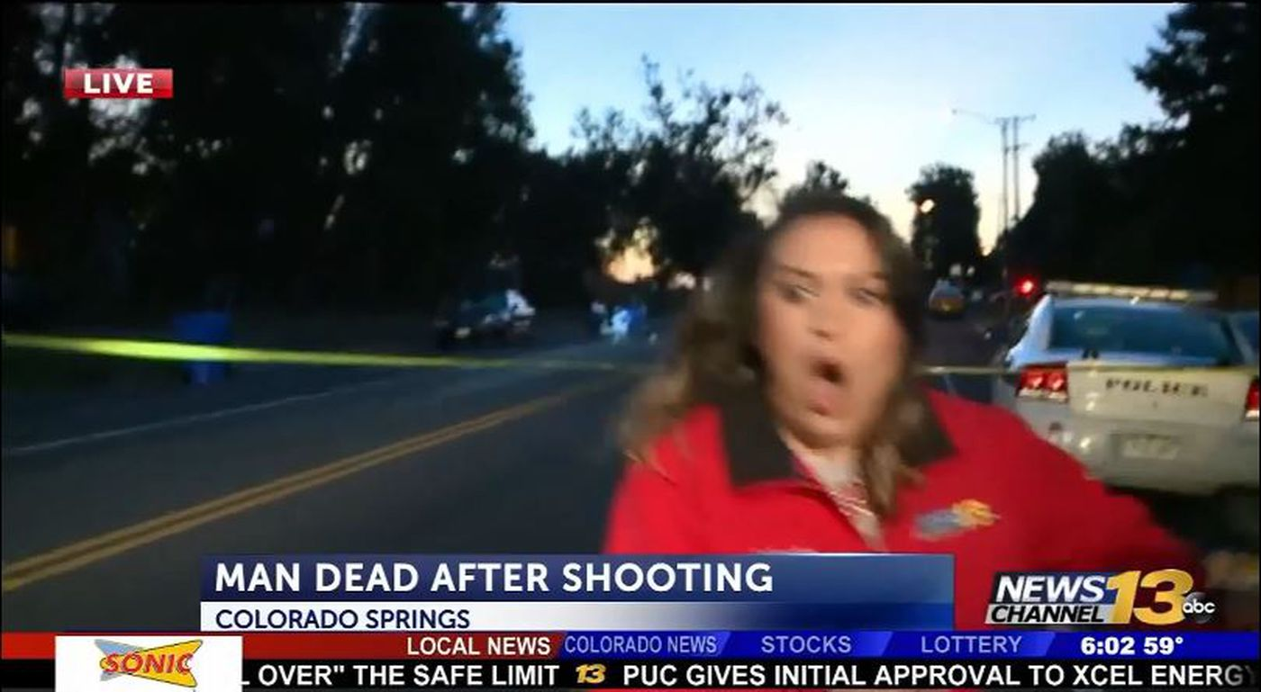 Driver nearly runs over TV news crew during live shot