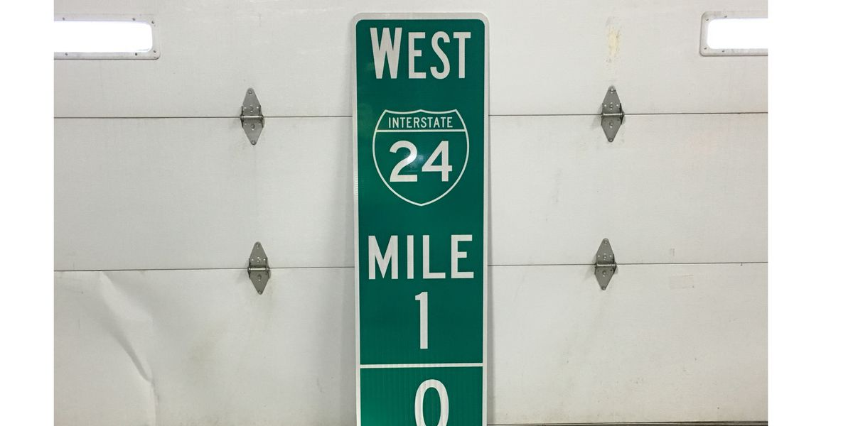 Crews installing new mile marker signs to help drivers with an emergency