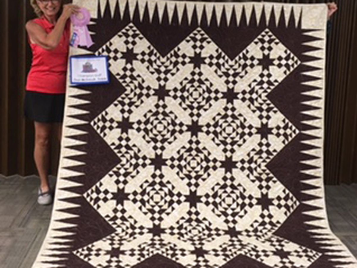 IL woman wins Grand Champion Ribbon for quilt at county fair