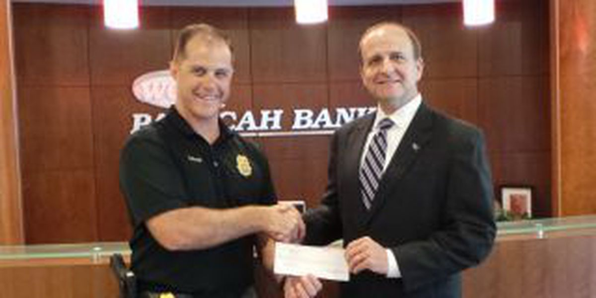 Business, police partner to offer child I.D. kits