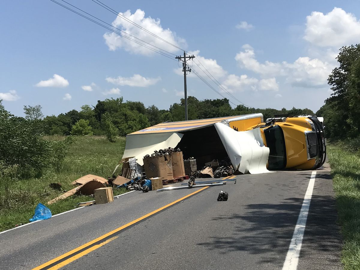 Semi hauling auto parts overturns, spills oil, blocks Ky. highway