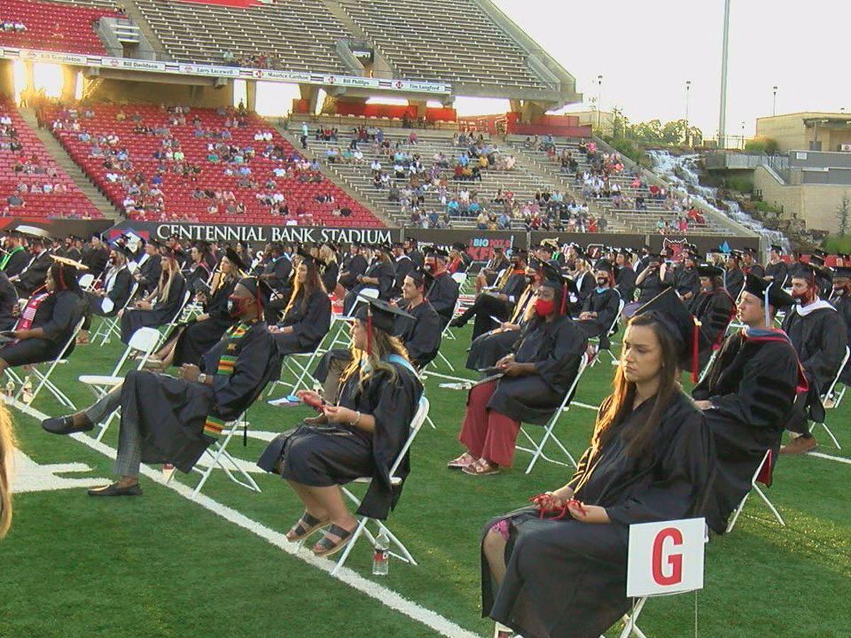 Summer graduates walk across the stage at Arkansas State University