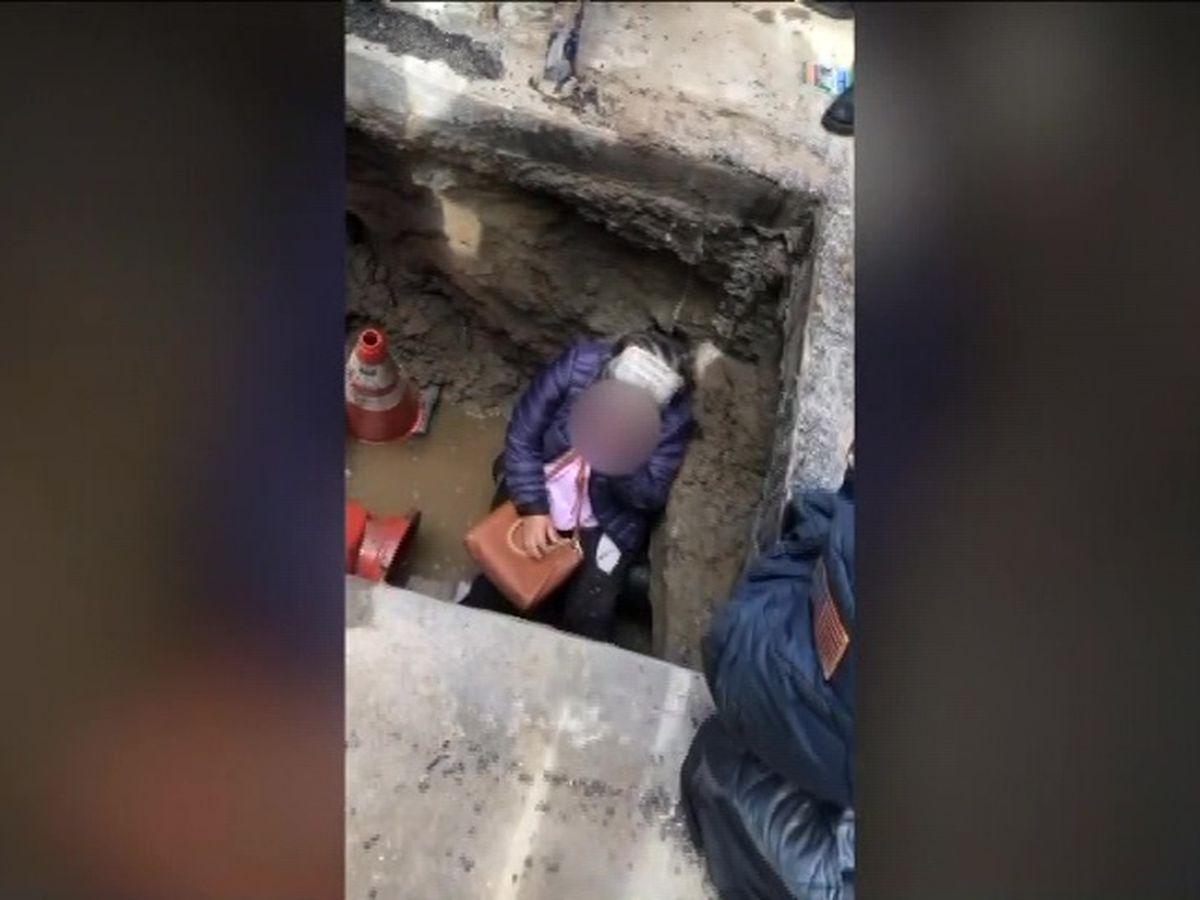 Woman falls through hole in New York City sidewalk