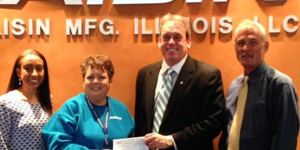 'Clothes for Kids' program presented with $1,500 check