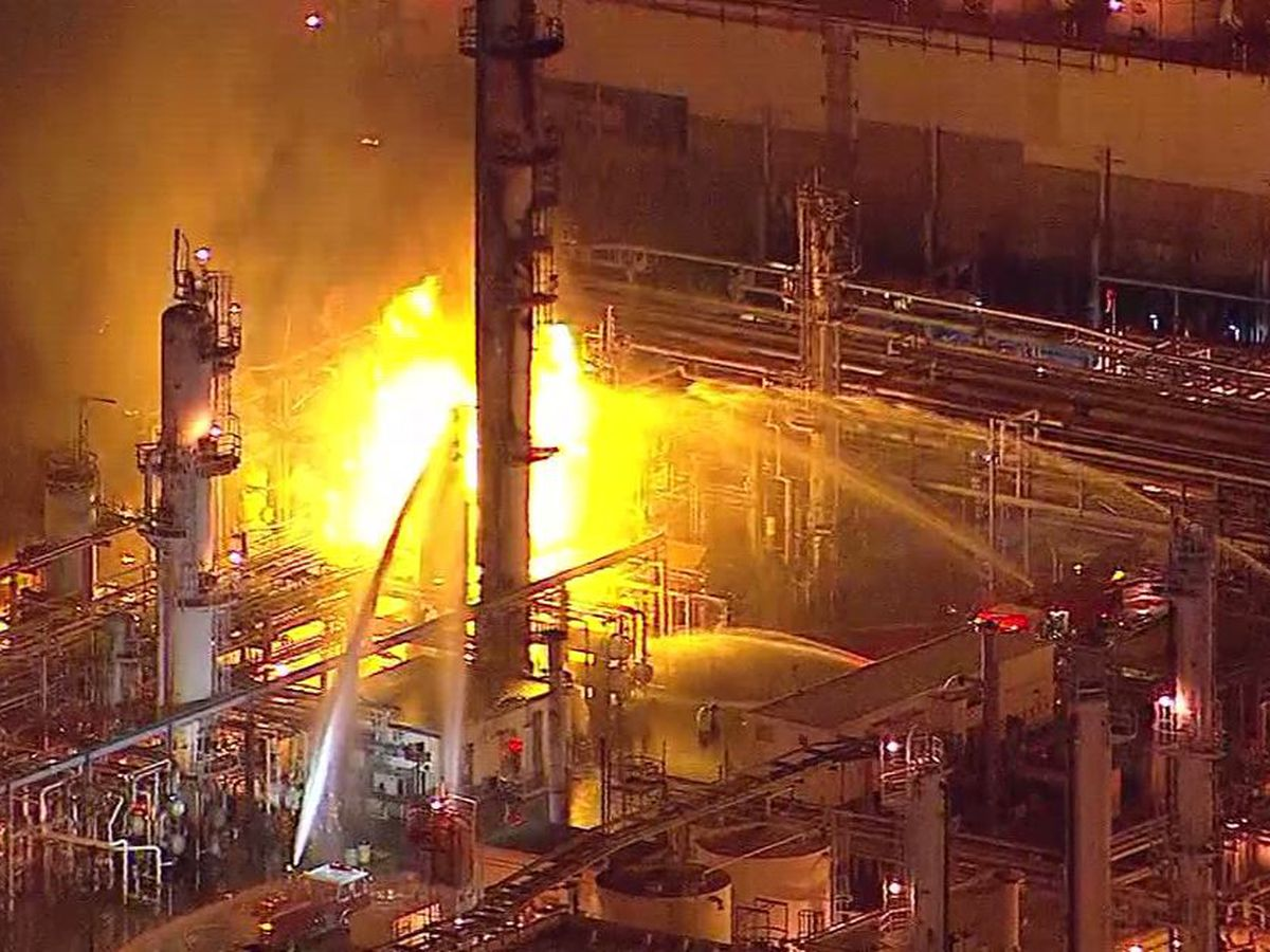 Firefighters respond to massive refinery fire after explosion near Los Angeles