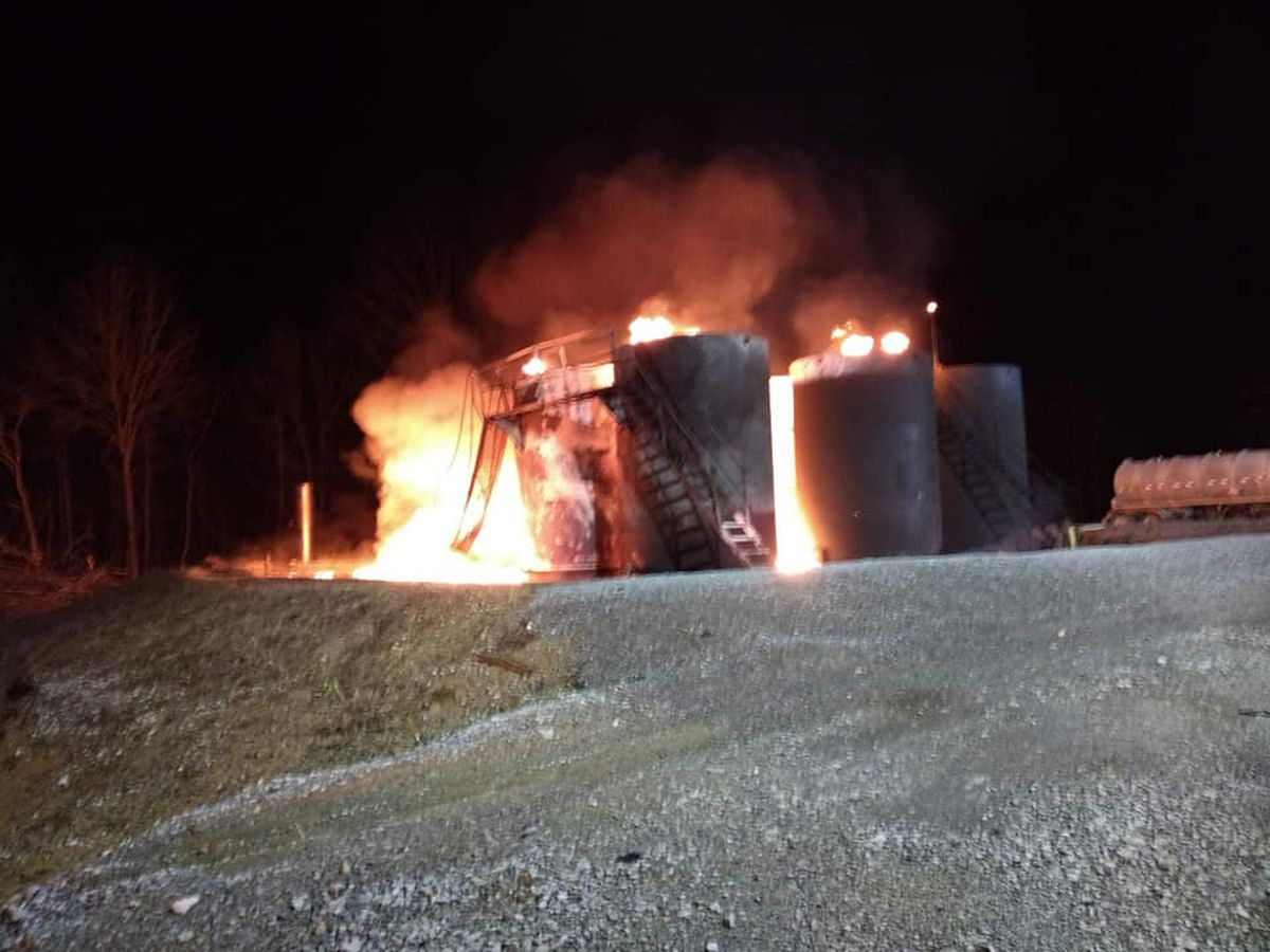 Crews battle fire at crude oil tanks; lightning likely to blame