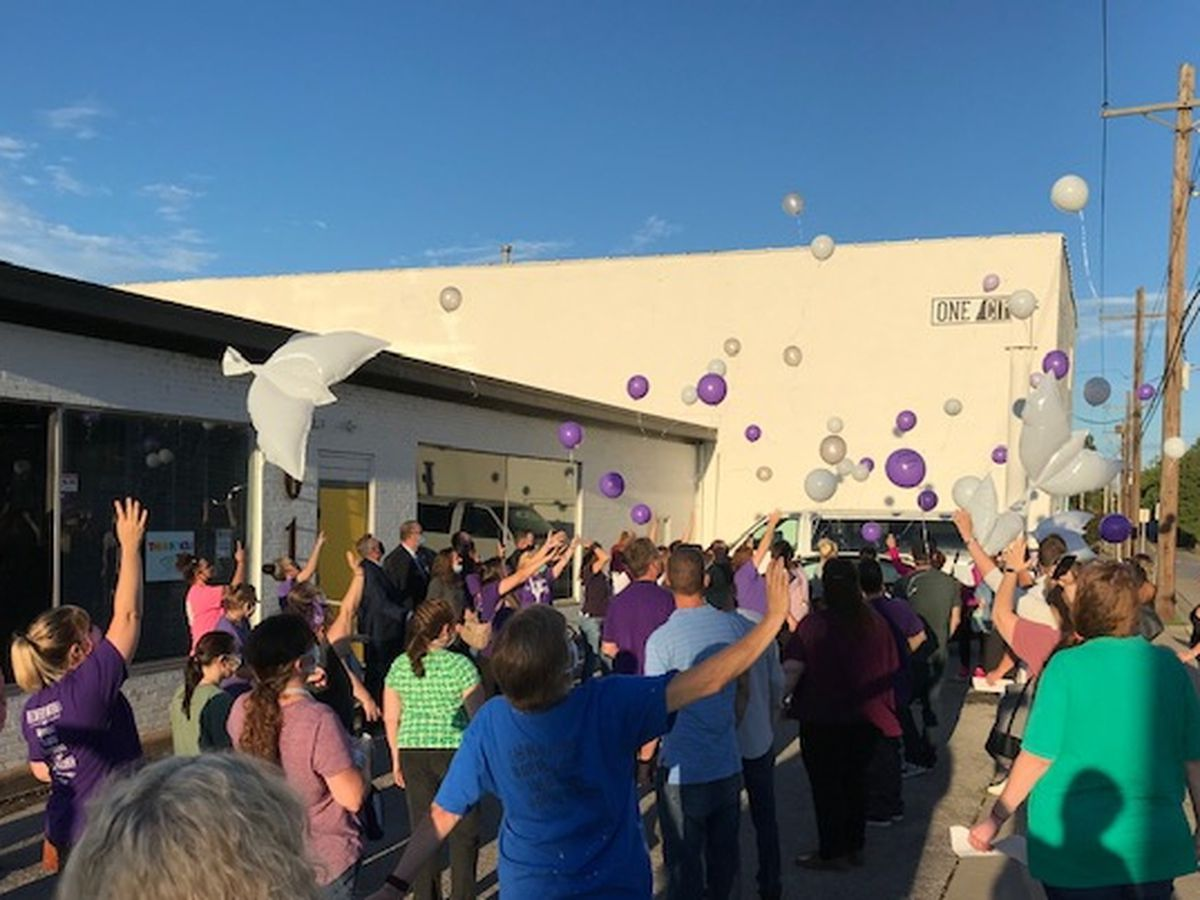 Crowd releases balloons for overdose awareness