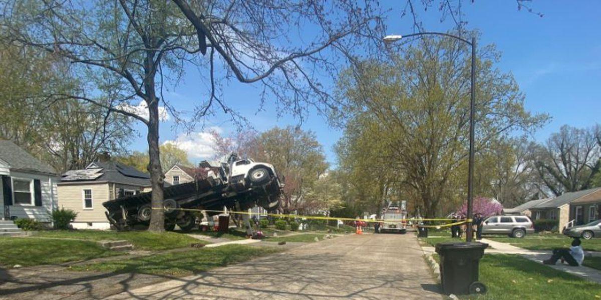 Crane falls onto home in west Louisville