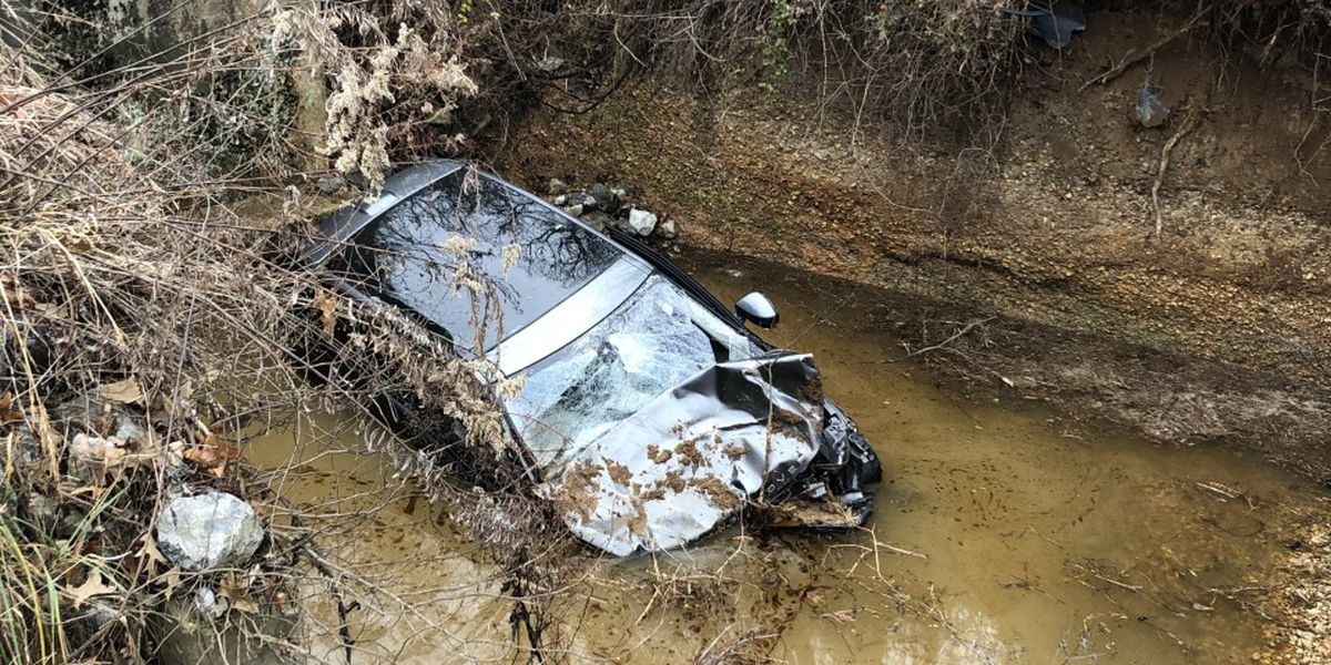 First Responders rescue trapped minors from car crash