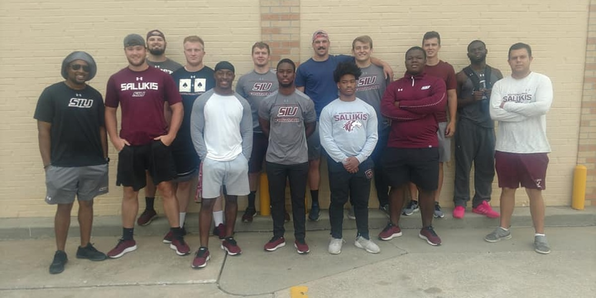 SIU football players fill 30 bags of trash while helping to keep things clean in Murphysboro, Ill.