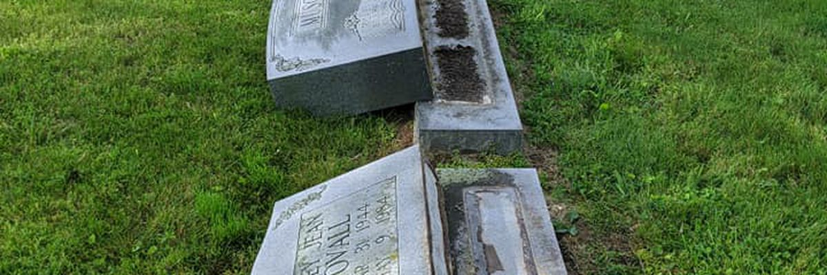 Multiple headstones toppled at cemetery, reward offered