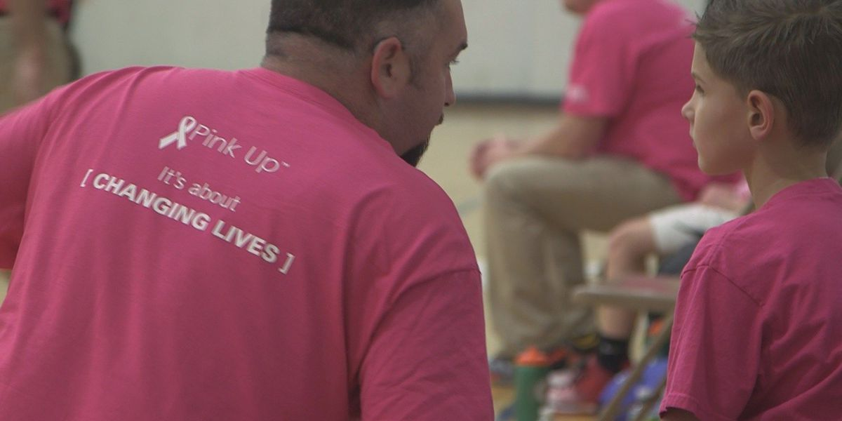 PINK UP: Third grade boys use pink jerseys to encourage breast cancer awareness