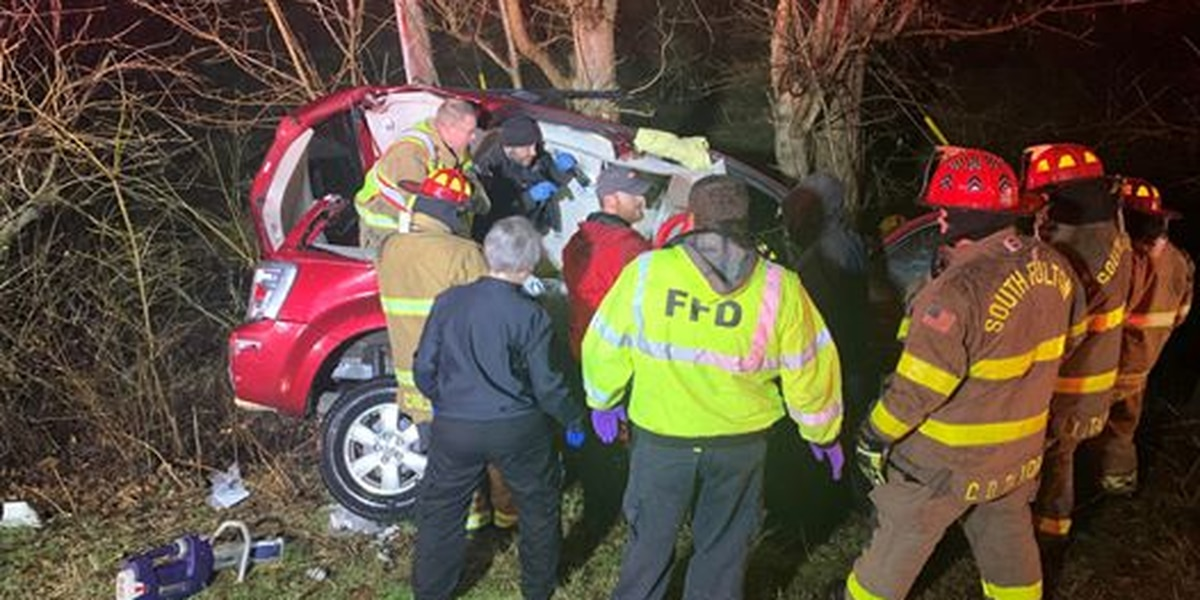 Woman rescued from crashed vehicle, pinned against tree