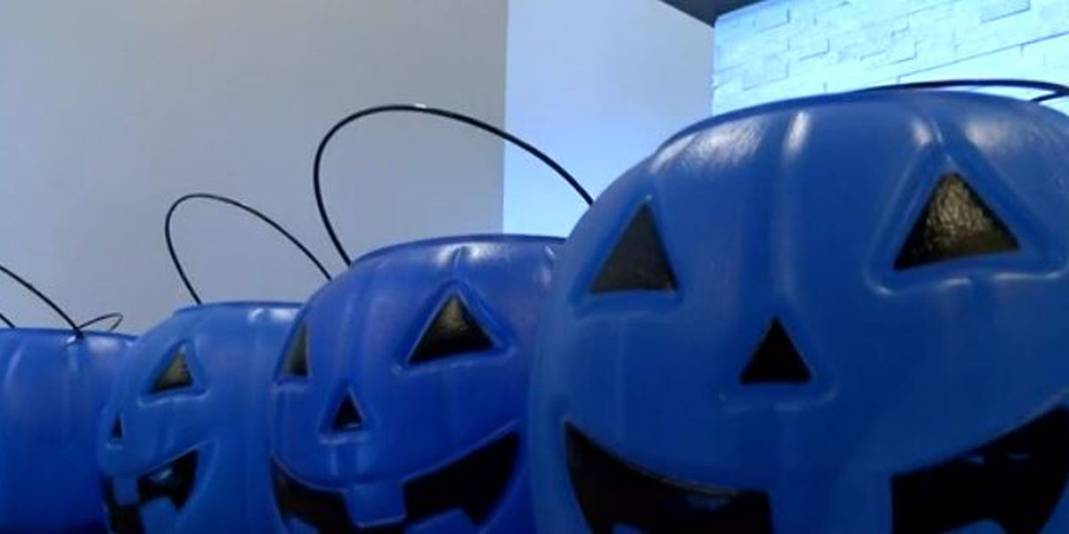 Blue trick-or-treat buckets bring autism awareness to Halloween