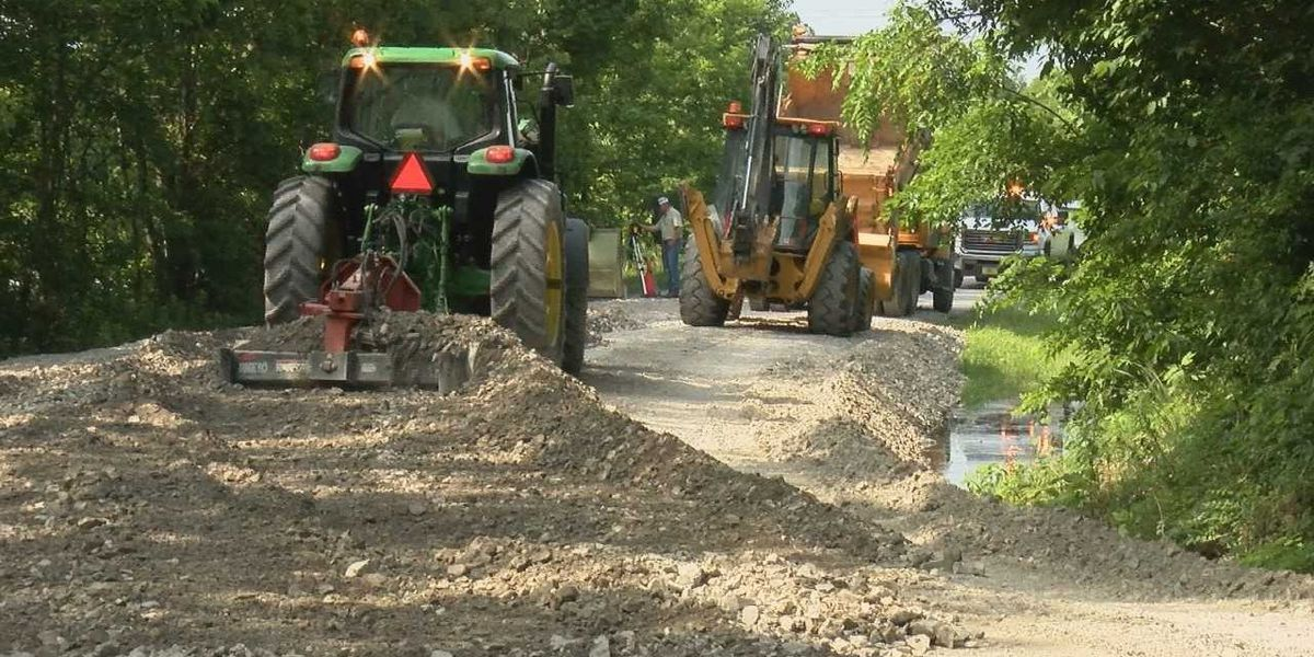 Heartland crews raise low-lying roads impacted by flood waters