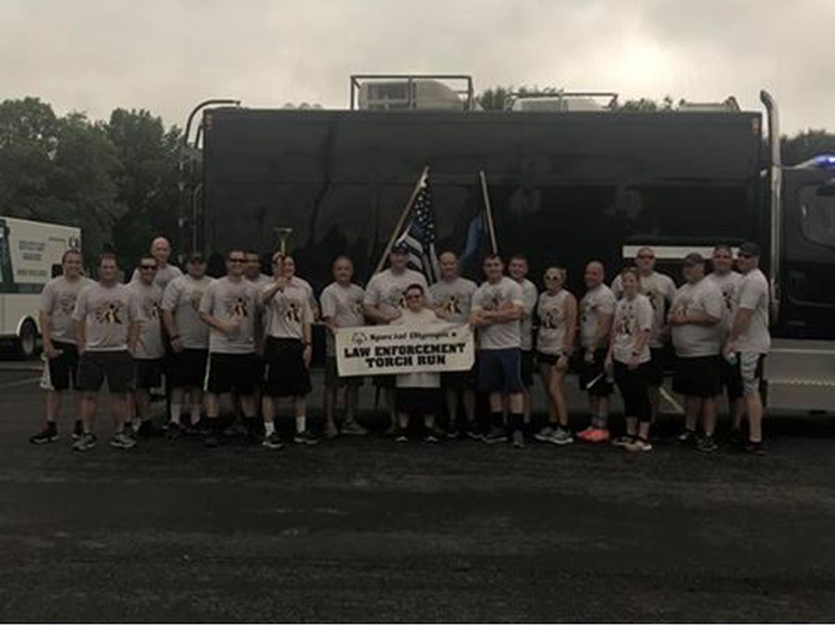 Law enforcement hold torch run for Special Olympics