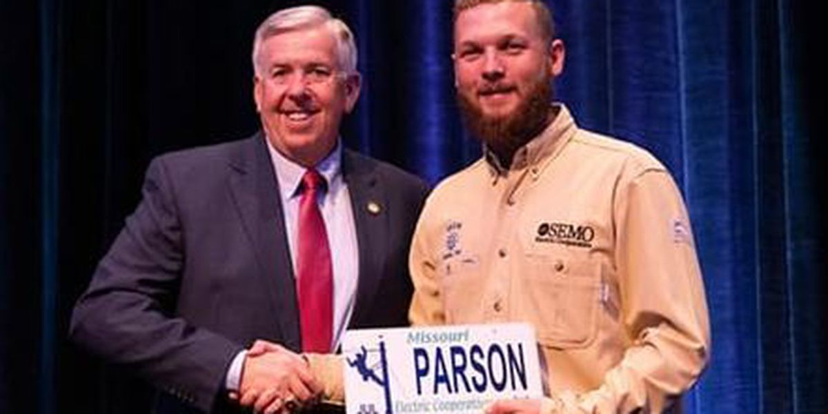 Lineman presents Mo. license plate to governor