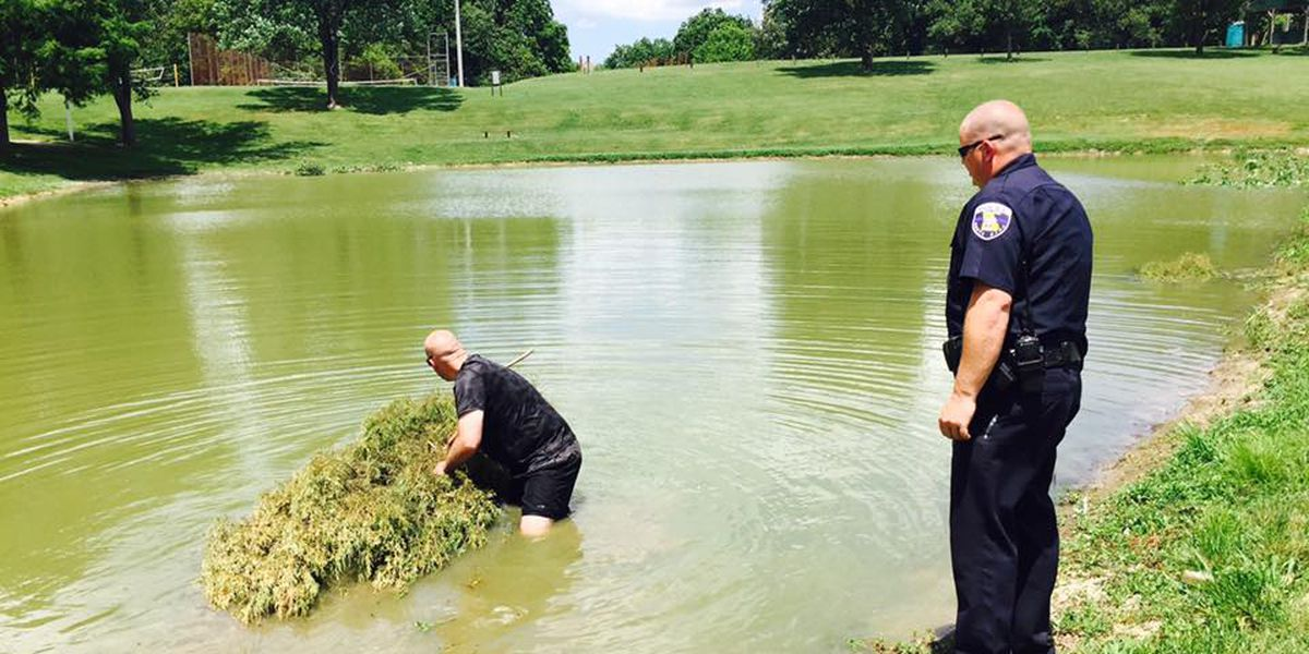 Scott City police officers get dirty to encourage community fishing