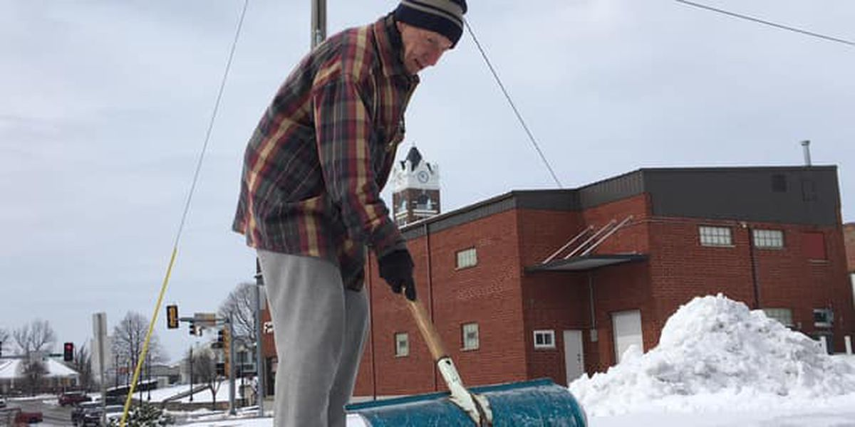 Elderly man scrapes off parking lot for fellow seniors