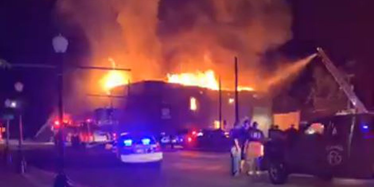 Firefighters work to contain fully involved fire at old newspaper building in Cairo, IL