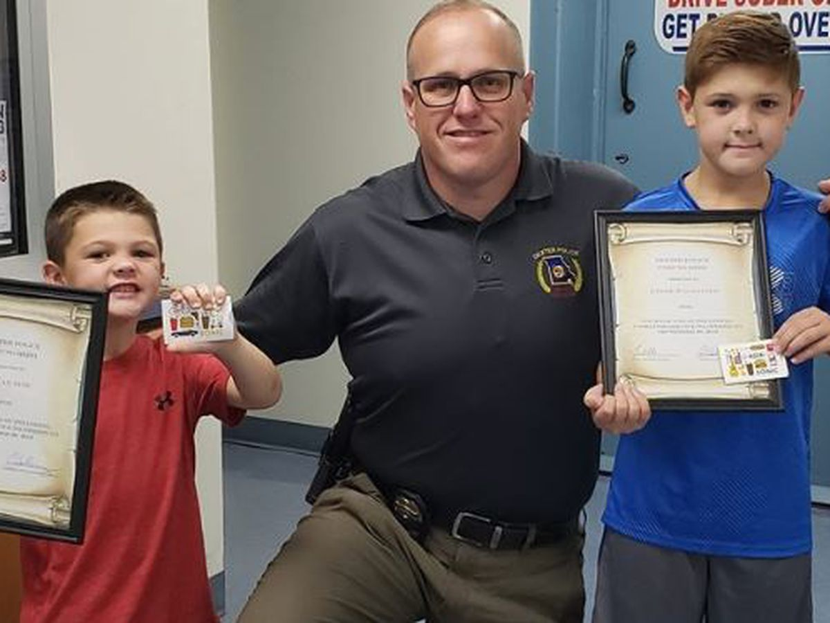 Young brothers recognized by Dexter PD after helping neighbor who fell into drainage ditch