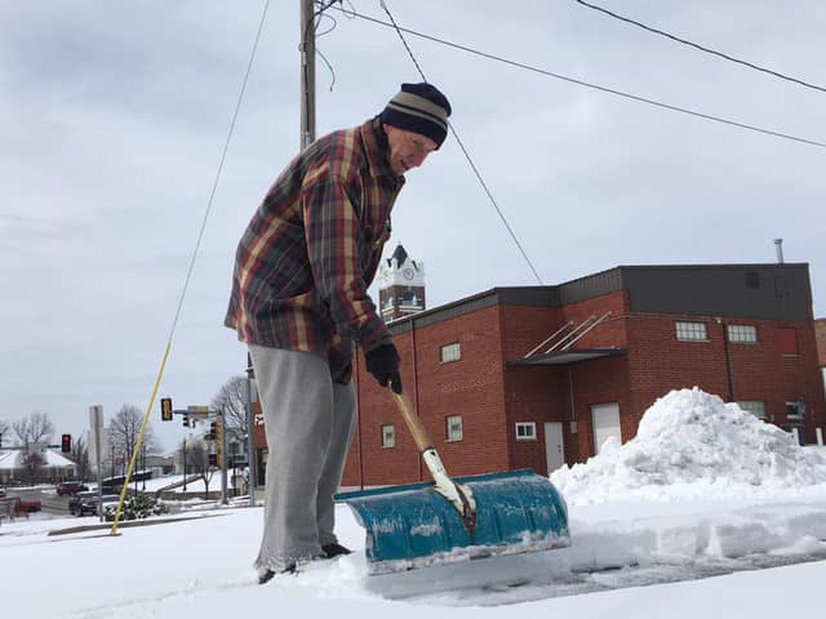 Elderly man scrapes off parking lot for fellow seniors
