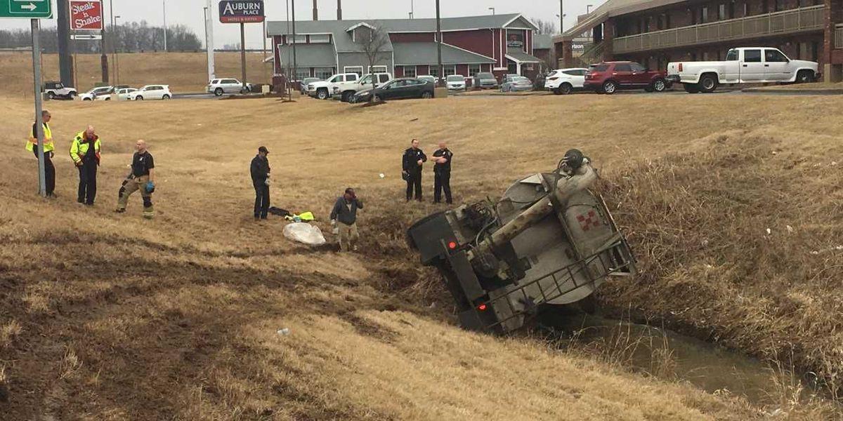 Ag truck overturned spilling fuel on NB I-55 at 96 mm