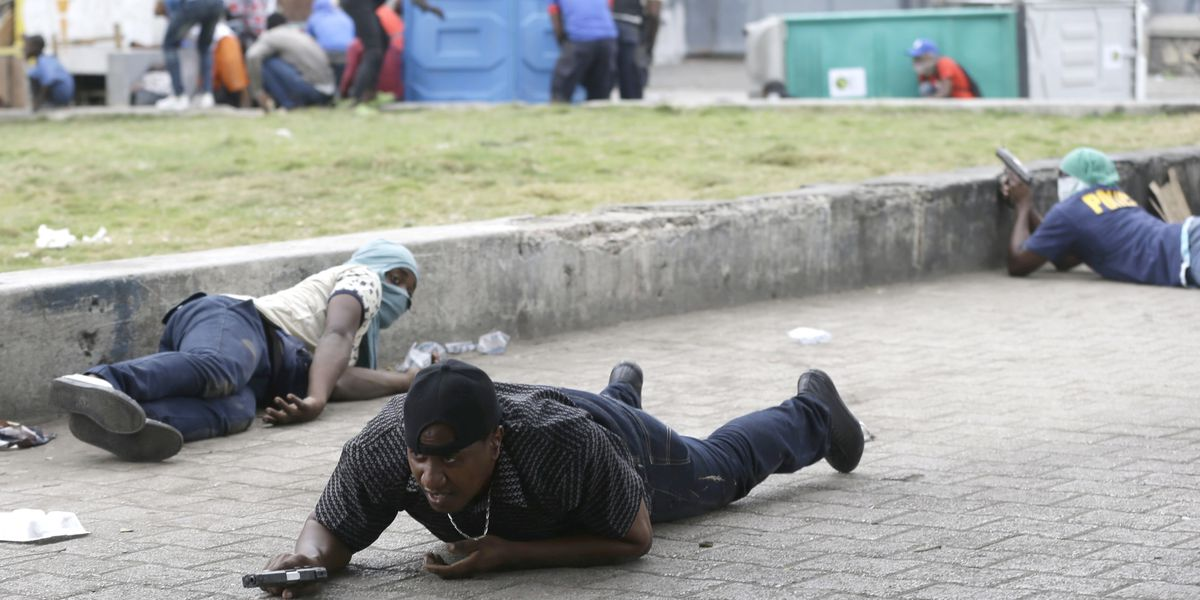 Haiti police exchange fire with troops near national palace