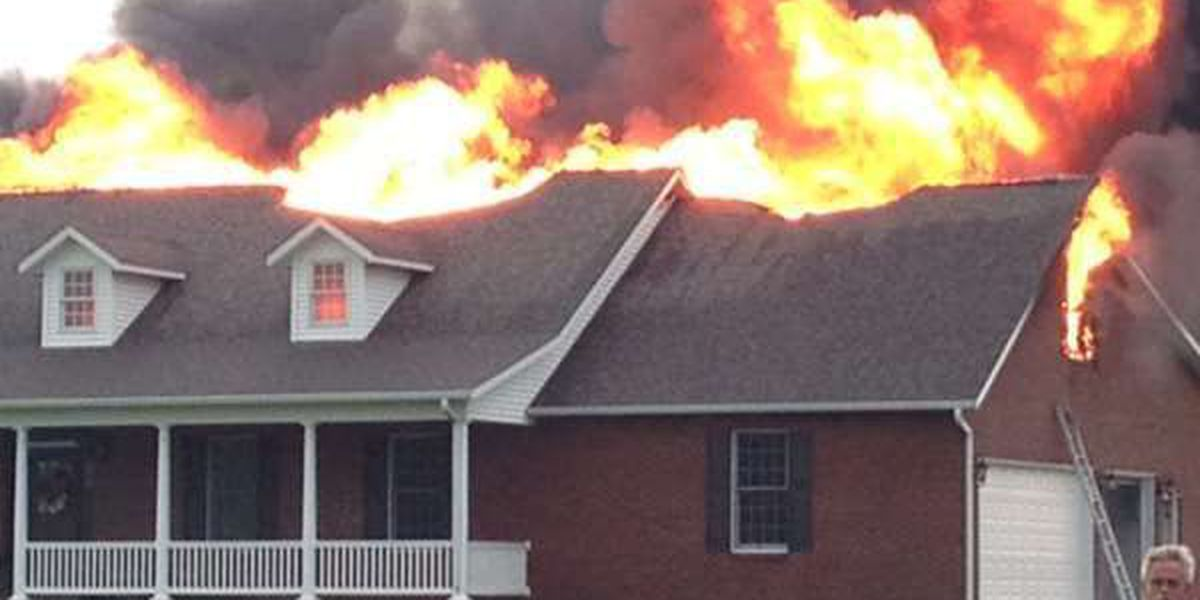 Home engulfed with flames in Scott County