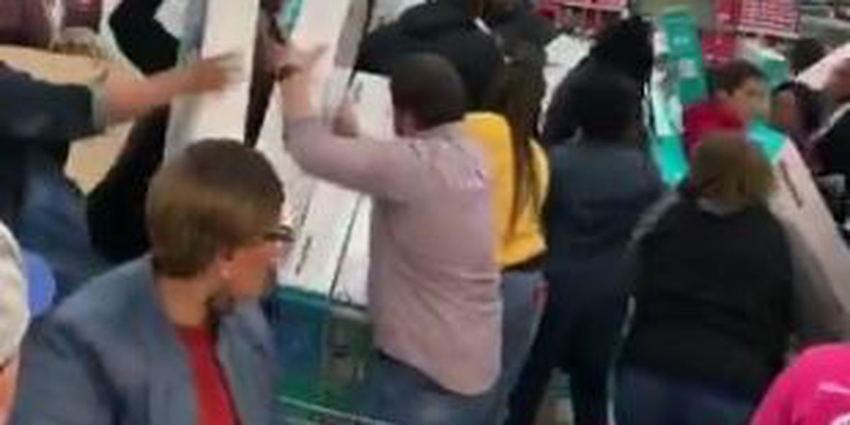 Black Friday shoppers frantically fill shopping carts with TVs at Myrtle Beach Walmart