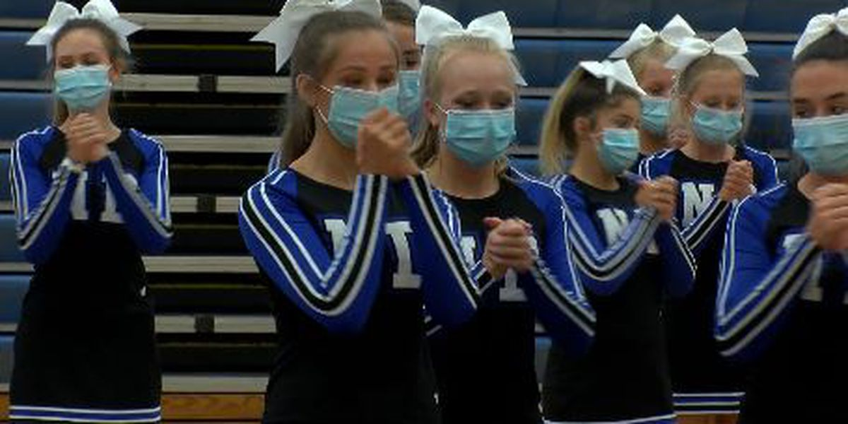 Cheering with masks as Mo. high school sports season begins