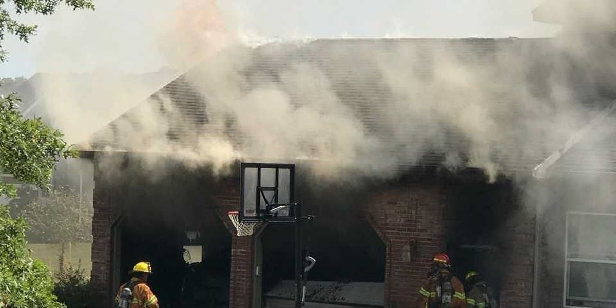 Firefighters working to put out house fire in Jackson