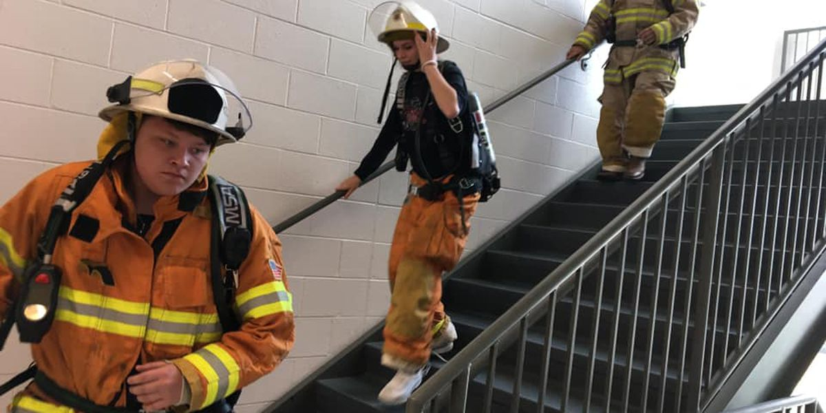 Jackson, Mo. students climb stairs with fire gear on